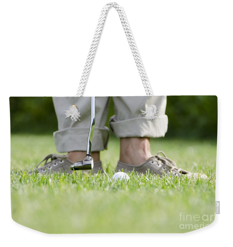 Golf. Sport Weekender Tote Bag featuring the photograph Playing Golf by Mats Silvan