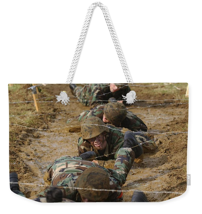 Annapolis Weekender Tote Bag featuring the photograph Plebes Low Crawl Under Barbwire As Part by Stocktrek Images