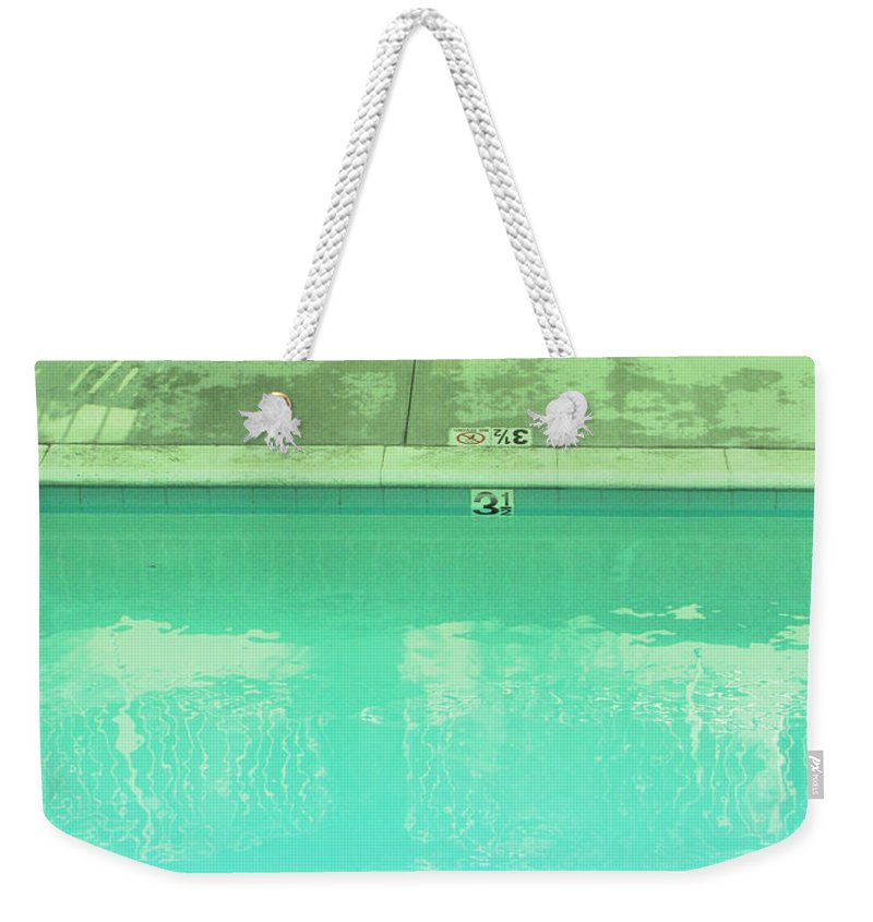 Pool Weekender Tote Bag featuring the photograph Poolside Seating by Kathleen Grace
