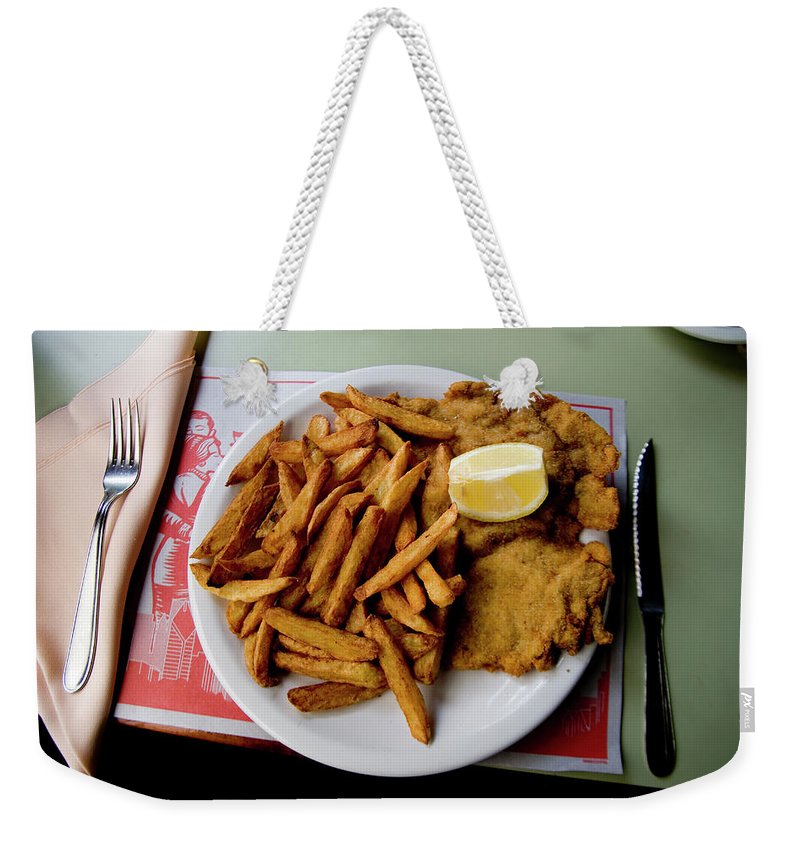 Buenos Aires Weekender Tote Bag featuring the photograph Popular Argentine Breaded-meat Dish by Stephen St. John