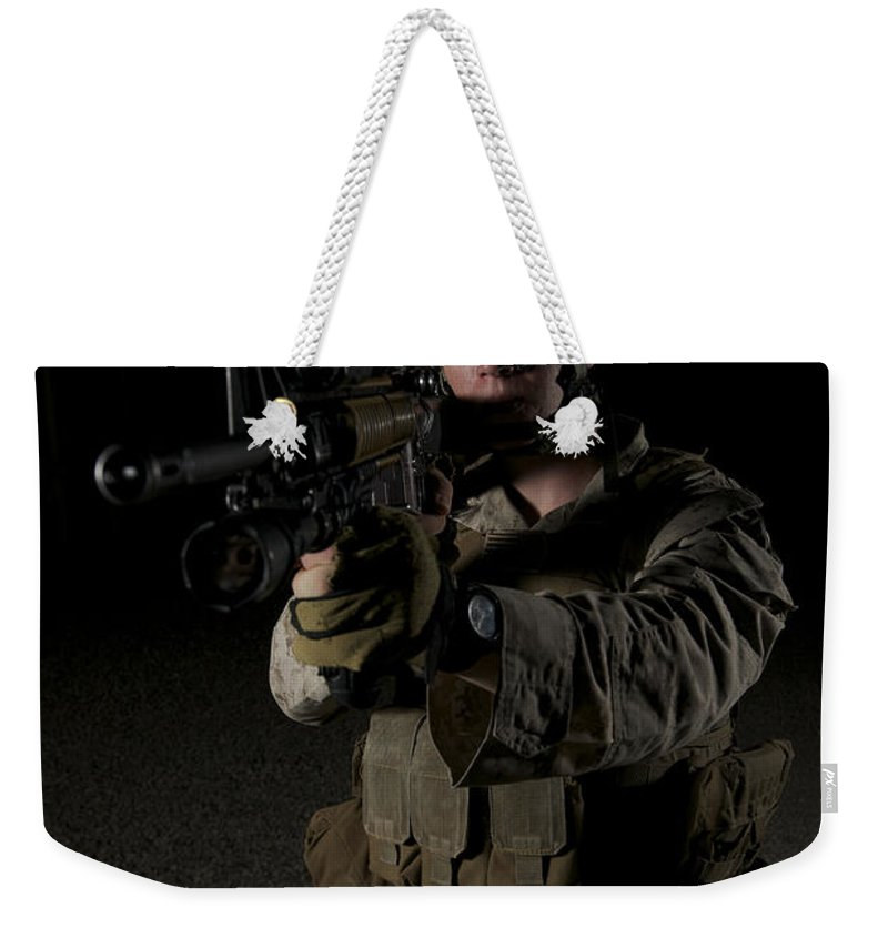Night Weekender Tote Bag featuring the photograph Portrait Of A U.s. Marine Wearing Night by Terry Moore