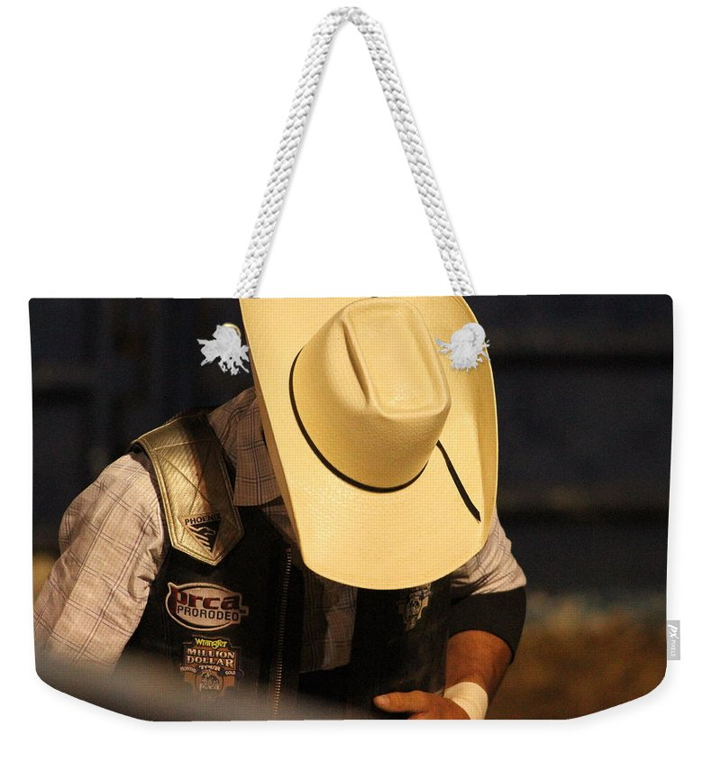 Rodeo Weekender Tote Bag featuring the photograph Preparation For The Ride by Laddie Halupa