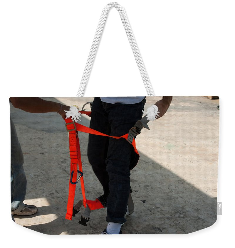 Orange Weekender Tote Bag featuring the photograph Preparing To Fit The Harness by Ashish Agarwal