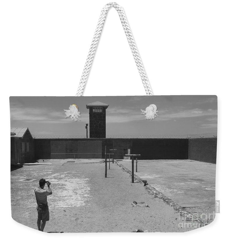 Robben Island Weekender Tote Bag featuring the photograph Prison Yard by Aidan Moran