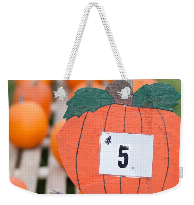 Clarence Holmes Weekender Tote Bag featuring the photograph Pumpkins For Sale II by Clarence Holmes