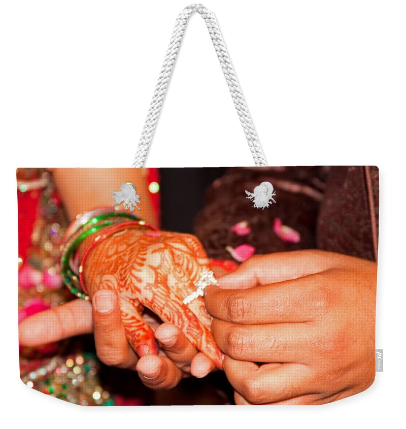 Man Weekender Tote Bag featuring the photograph Putting The Gold And Diamond Engagement Ring On The Finger Of The Lady by Ashish Agarwal