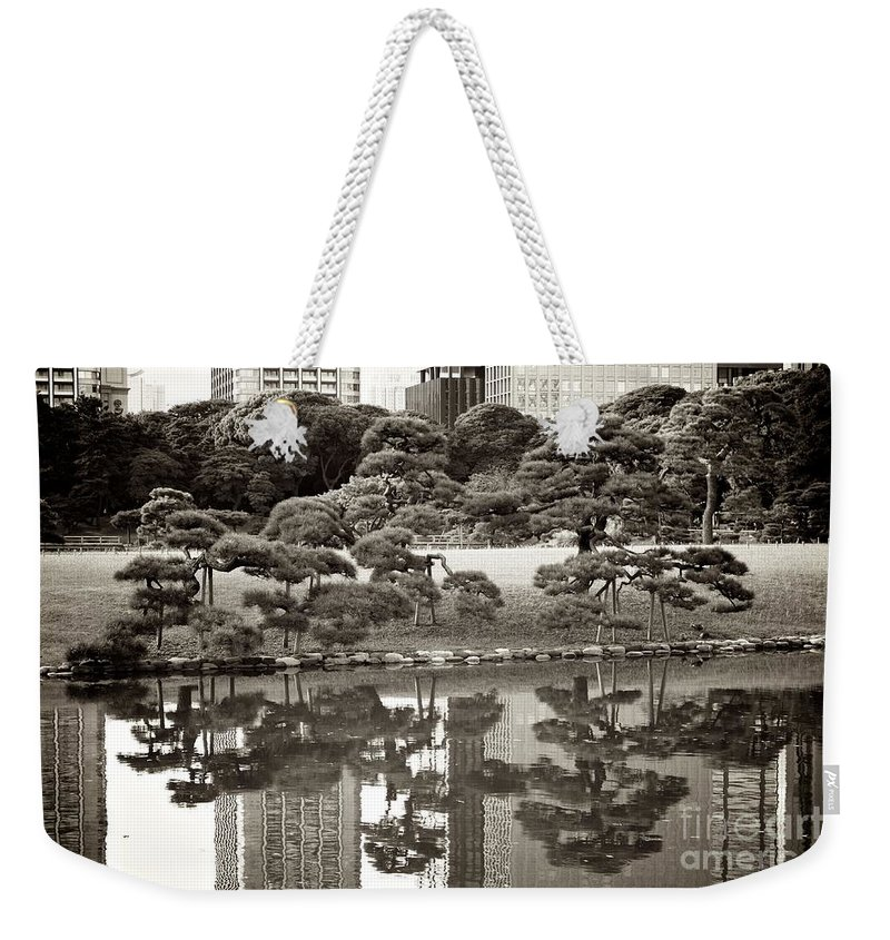 Tokyo Weekender Tote Bag featuring the photograph Quiet Moment In Tokyo by Carol Groenen