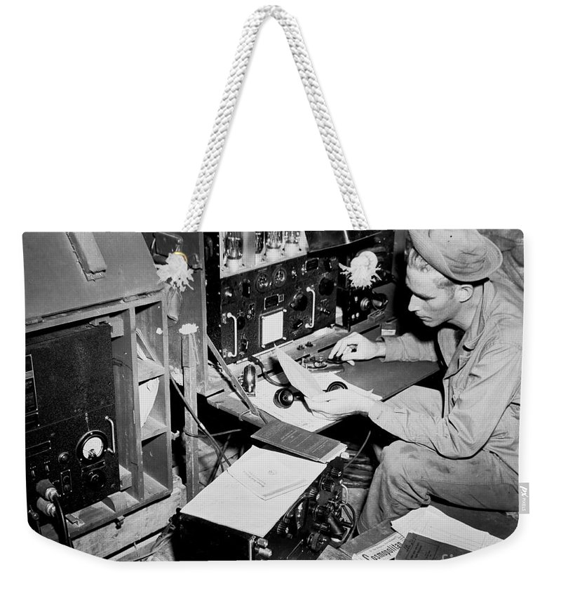 War Weekender Tote Bag featuring the photograph Radio Operator Operates His Scr-188 by Stocktrek Images