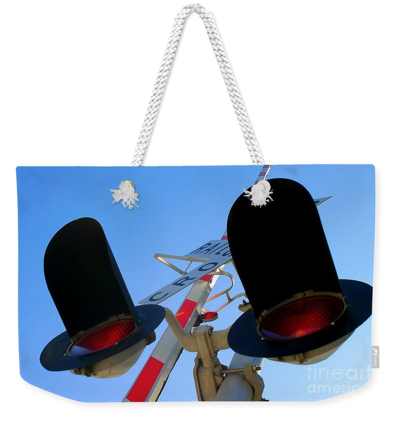 Crossing Weekender Tote Bag featuring the photograph Rail Cro by Henrik Lehnerer