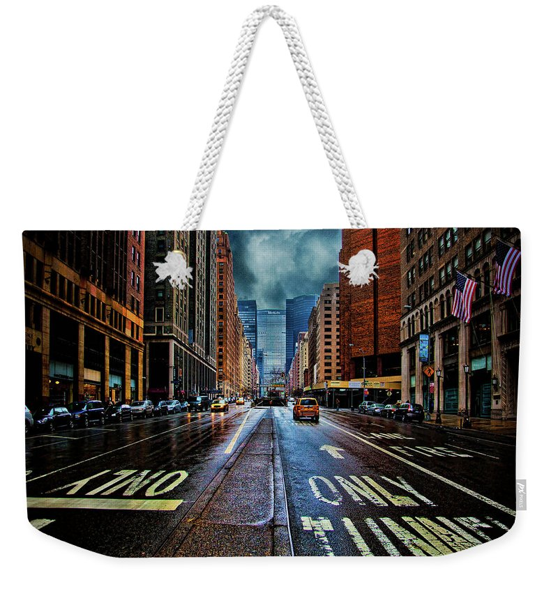 New York Weekender Tote Bag featuring the photograph Rain On Park Avenue by Chris Lord