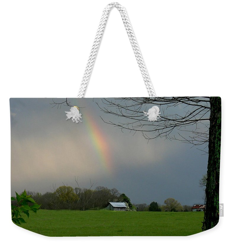Tn Weekender Tote Bag featuring the photograph Rainbow After The Rain by Ericamaxine Price