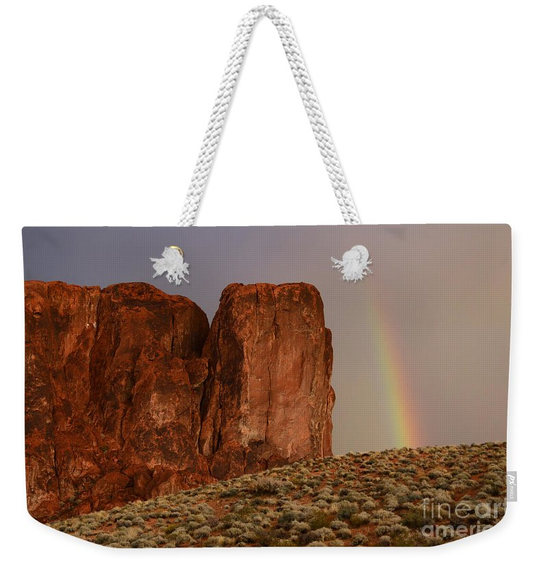 Sandstone Weekender Tote Bag featuring the photograph Rainbow And Red Rock by Bob Christopher