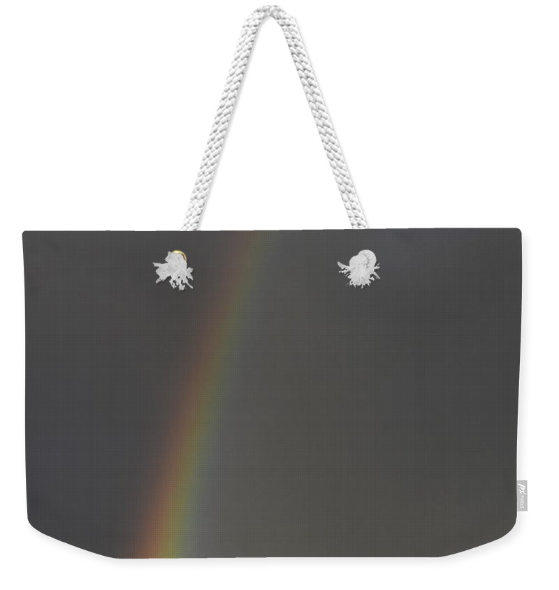 Sandstone Weekender Tote Bag featuring the photograph Rainbow Over Sandstone by Bob Christopher