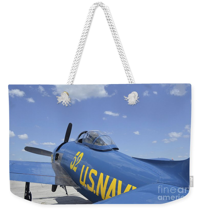 Lakeland Weekender Tote Bag featuring the photograph Rear View Of A F8f Bearcat Parked by Stocktrek Images