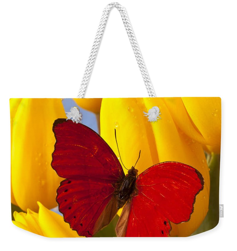 Red Weekender Tote Bag featuring the photograph Red Butterful On Yellow Tulips by Garry Gay