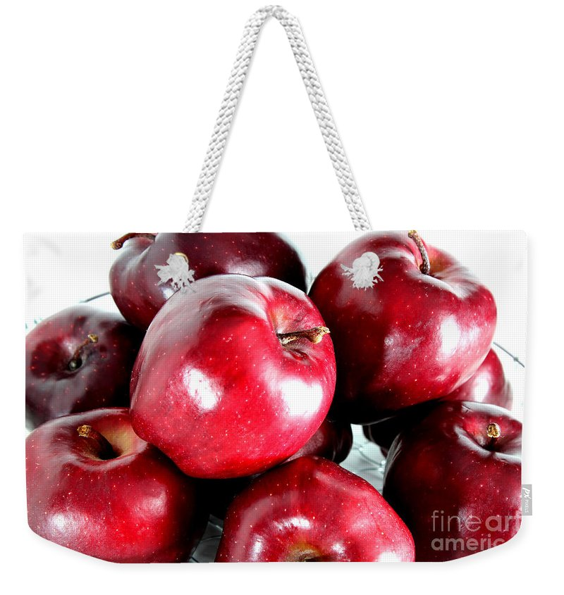 Red Weekender Tote Bag featuring the photograph Red Delicious Apples by Barbara Griffin