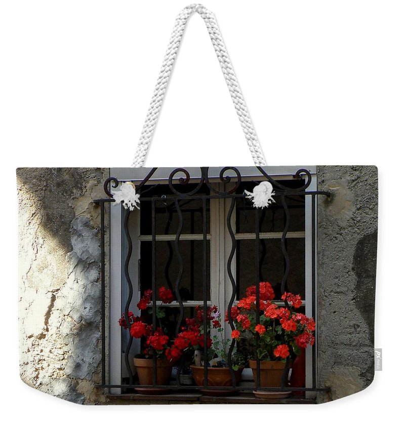 Windows Weekender Tote Bag featuring the photograph Red Geraniums In Window by Lainie Wrightson