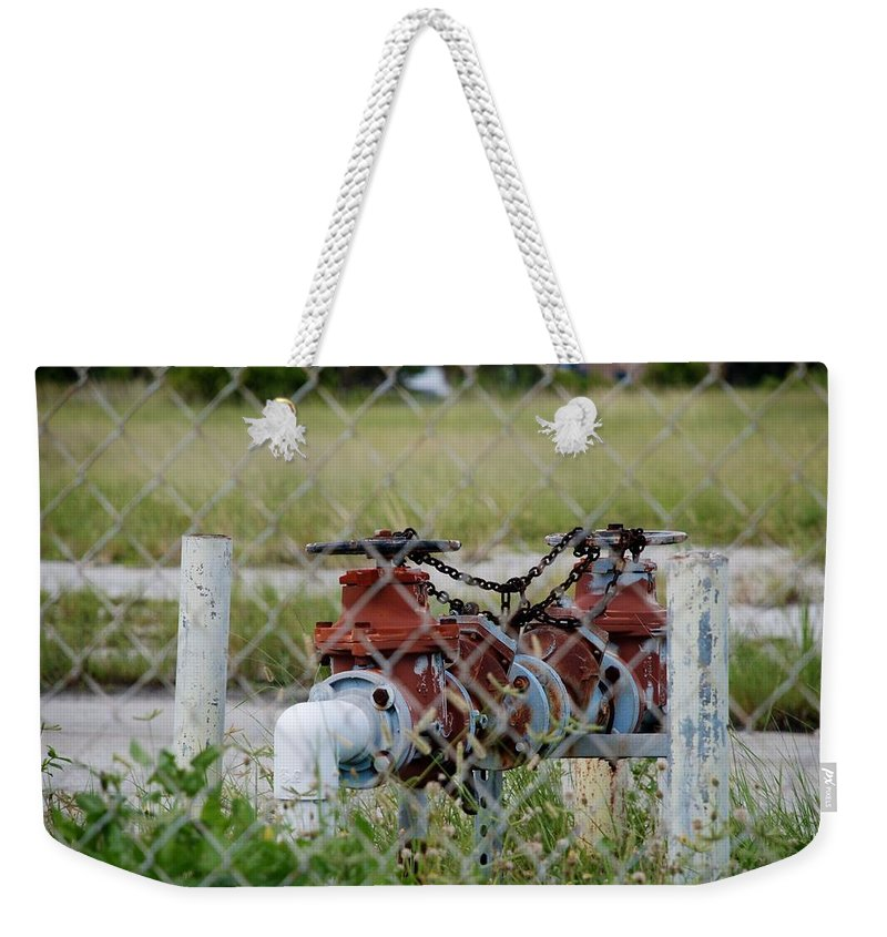 Valves Weekender Tote Bag featuring the photograph Red Mechanical Valves by Rob Hans