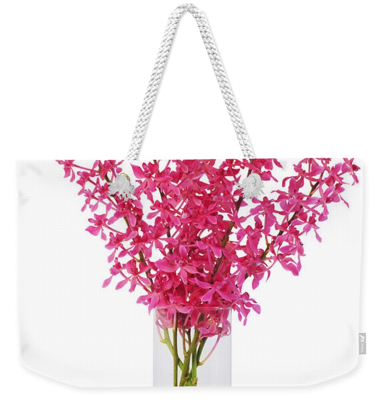 Asian Weekender Tote Bag featuring the photograph Red Orchid In Vase by Atiketta Sangasaeng