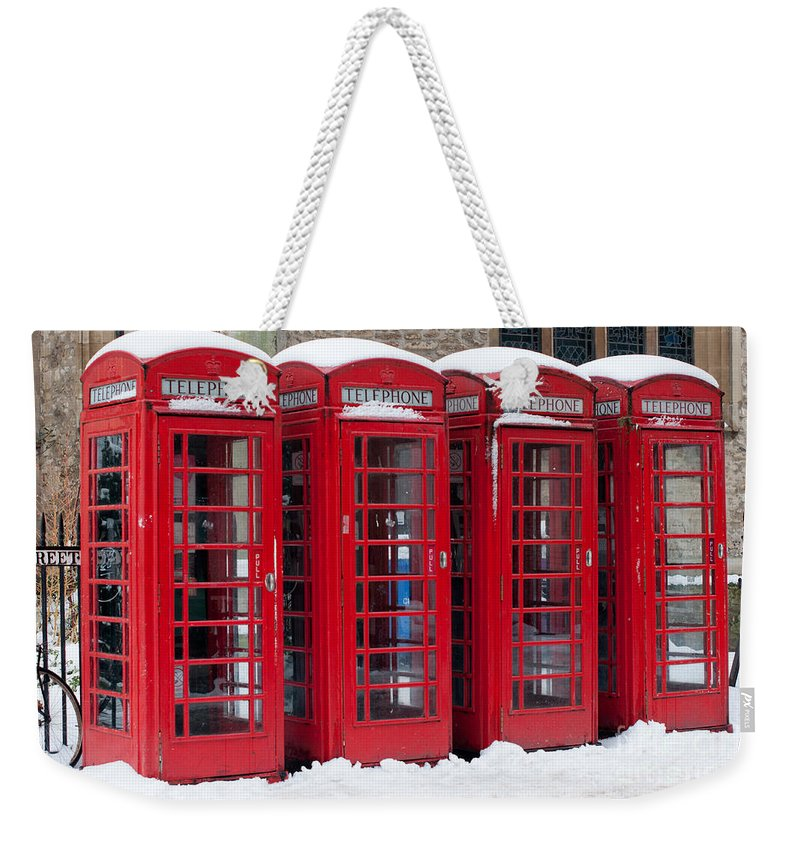 Red Weekender Tote Bag featuring the photograph Red Phone Boxes by Andrew Michael