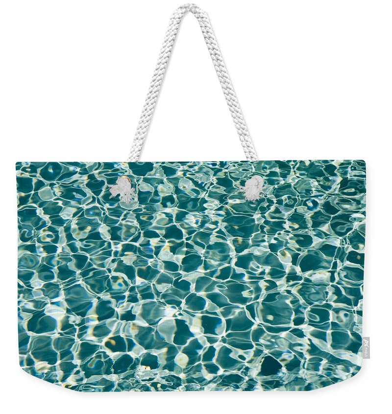 Sunlight Weekender Tote Bag featuring the photograph Reflections In A Swimming Pool by Tim Laman