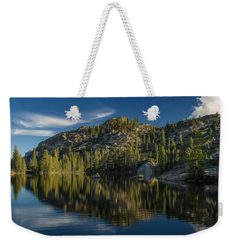 Salmon Lake Weekender Tote Bag featuring the photograph Reflections On Salmon Lake by Greg Nyquist