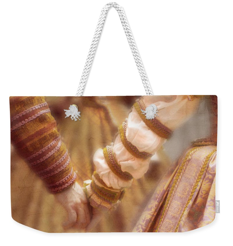 Woman Weekender Tote Bag featuring the photograph Renaissance Couple Holding Hands by Jill Battaglia