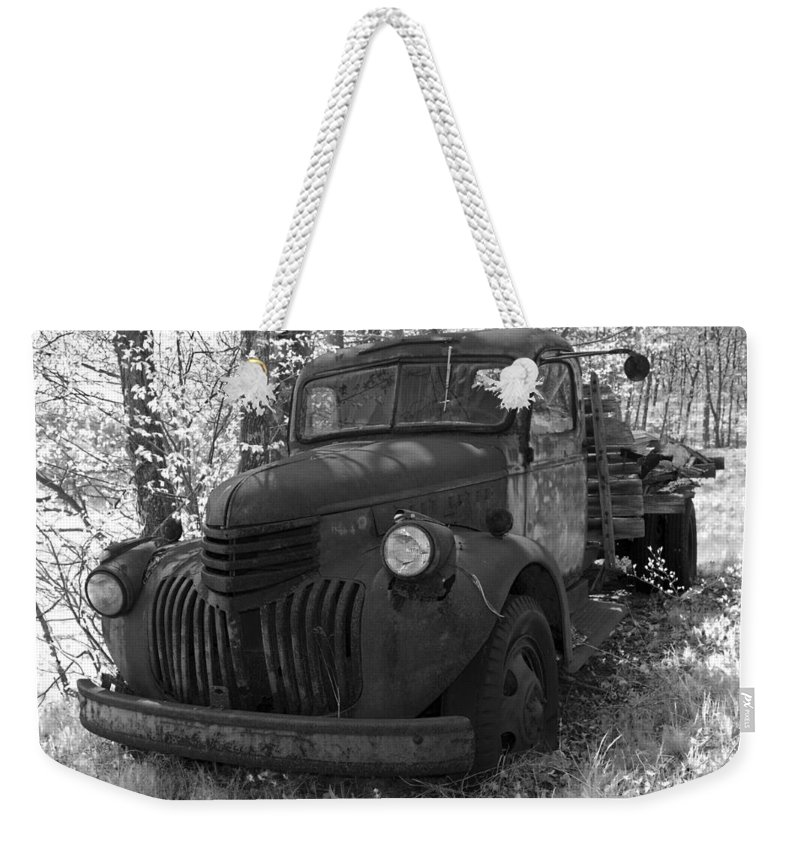 Rustic Weekender Tote Bag featuring the photograph Retired Rusty Relic Farm Truck by John Stephens