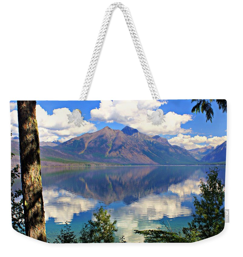 Glacier National Park Weekender Tote Bag featuring the photograph Rflection On Lake Mcdonald by Marty Koch