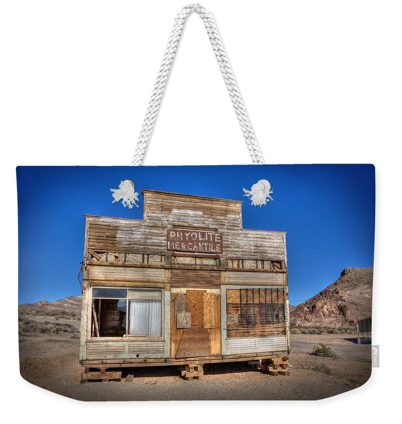 Abandoned Weekender Tote Bag featuring the photograph Rhyolite Mercatile by Peter Tellone