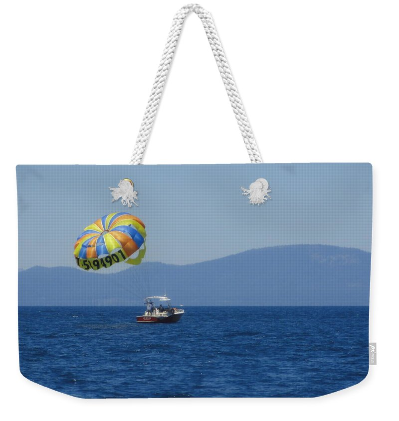 Water Weekender Tote Bag featuring the photograph Ride The Wind by Shannon Grissom