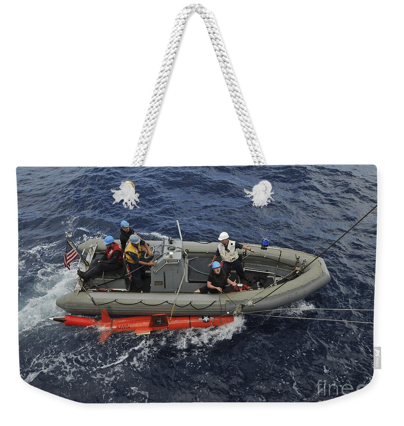 Aerial Drone Weekender Tote Bag featuring the photograph Rigid-hull Inflatable Boat Operators by Stocktrek Images