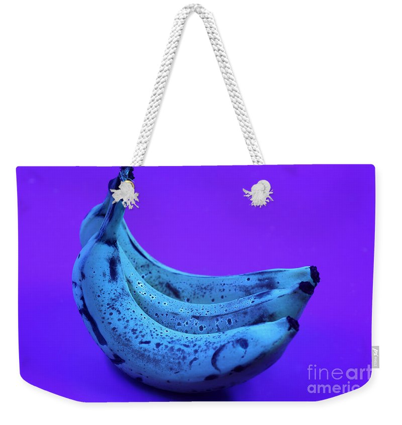 Food Weekender Tote Bag featuring the photograph Ripe Bananas In Uv Light 22 by Ted Kinsman