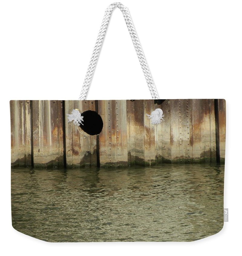 Rust Weekender Tote Bag featuring the photograph River In The City 1 by Anita Burgermeister
