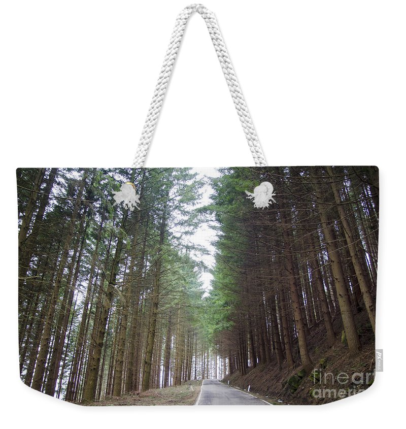 Road Weekender Tote Bag featuring the photograph Road In The Forest by Mats Silvan