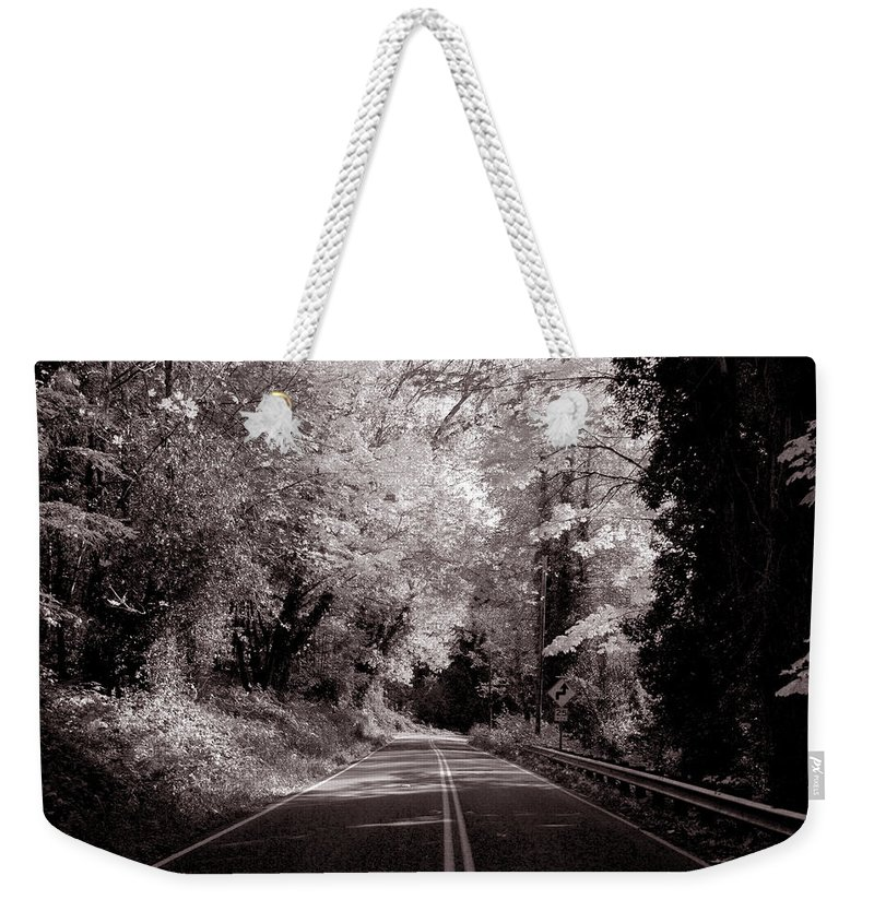 Landscape Weekender Tote Bag featuring the photograph Road Through Autumn - Black And White by Kathleen Grace