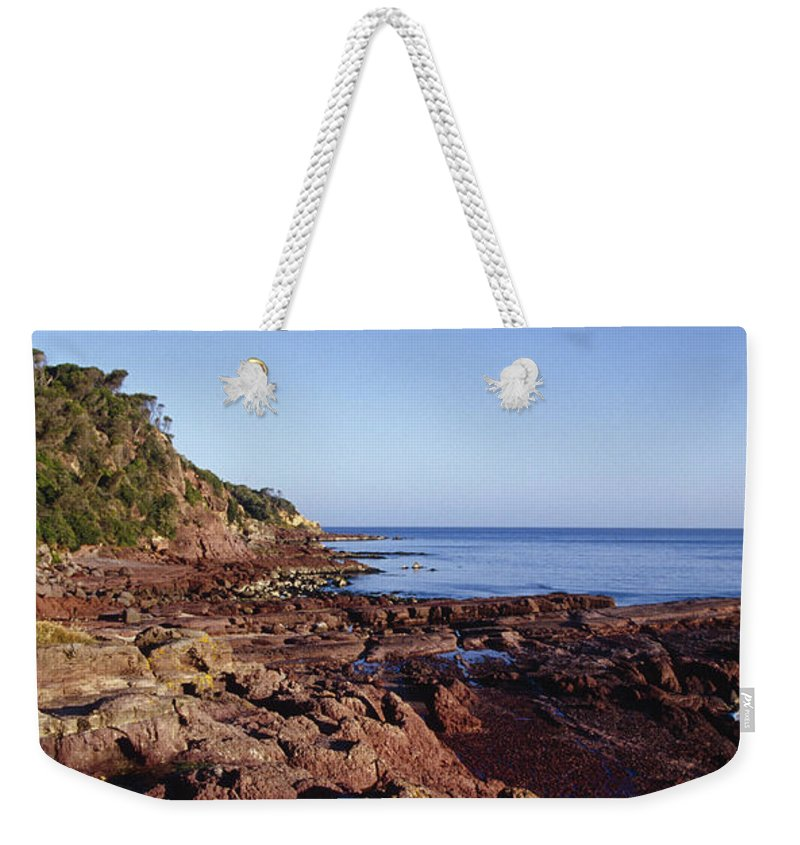Volcanic Weekender Tote Bag featuring the photograph Rockpools In Volcanic Rock Formations by Jason Edwards