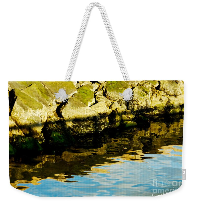 Clouds Weekender Tote Bag featuring the photograph Rocks And Reflections On Ocean by Carol F Austin
