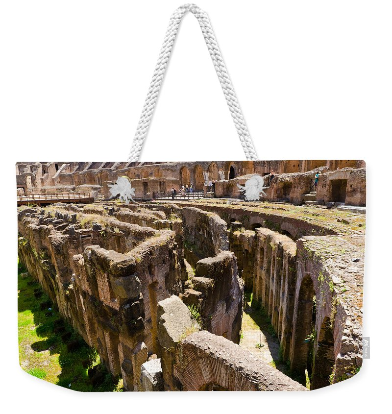 Rome Weekender Tote Bag featuring the photograph Roman Coliseum Underground by Jon Berghoff