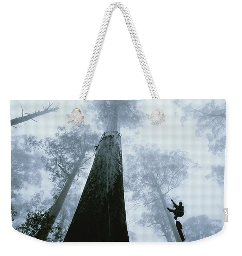 Model Released Photography Weekender Tote Bag featuring the photograph Roman Dial Preforms An Ecological by Bill Hatcher