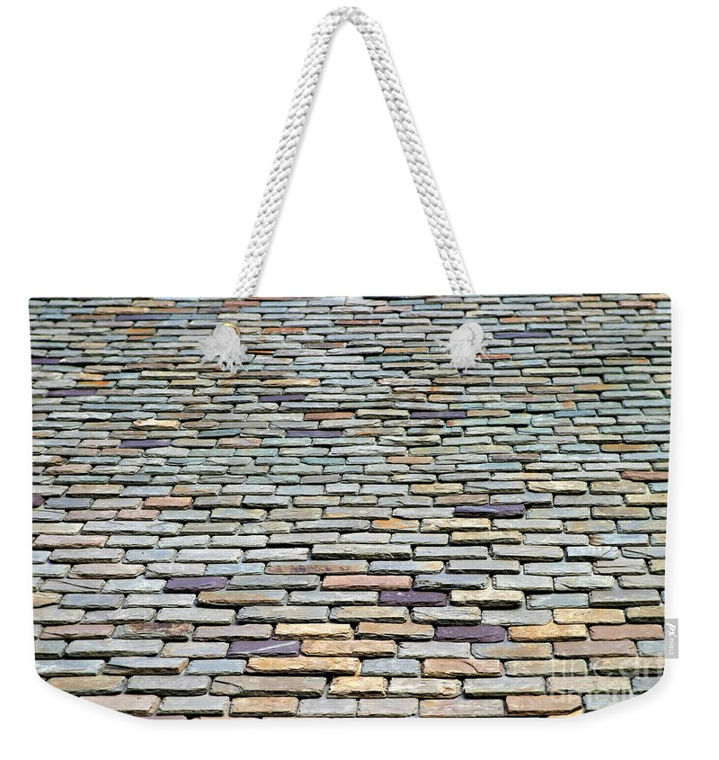 Stone Weekender Tote Bag featuring the photograph Roof Tiles by Henrik Lehnerer