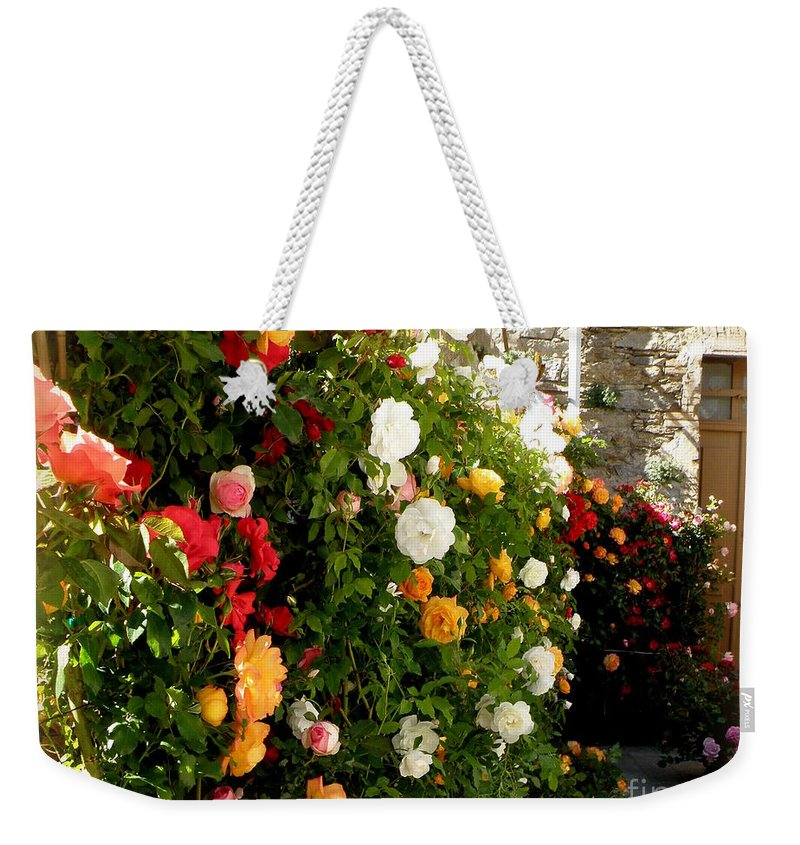 Roses Weekender Tote Bag featuring the photograph Roses Roses Everywhere by Lainie Wrightson