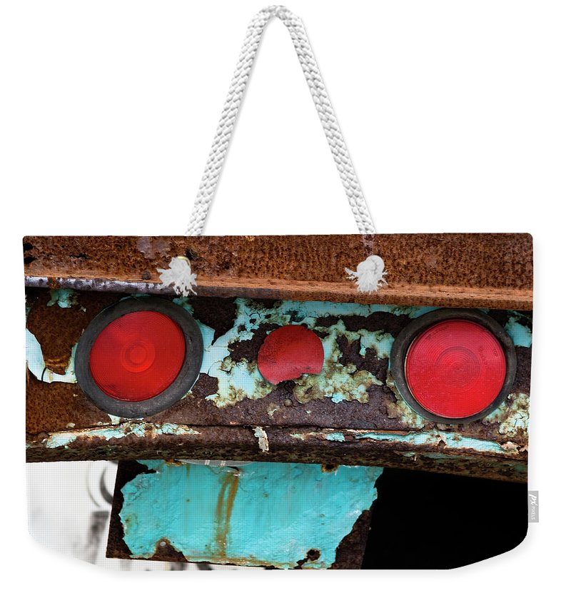 Taillight Weekender Tote Bag featuring the photograph Rusted Blue Taillight by Lorraine Devon Wilke