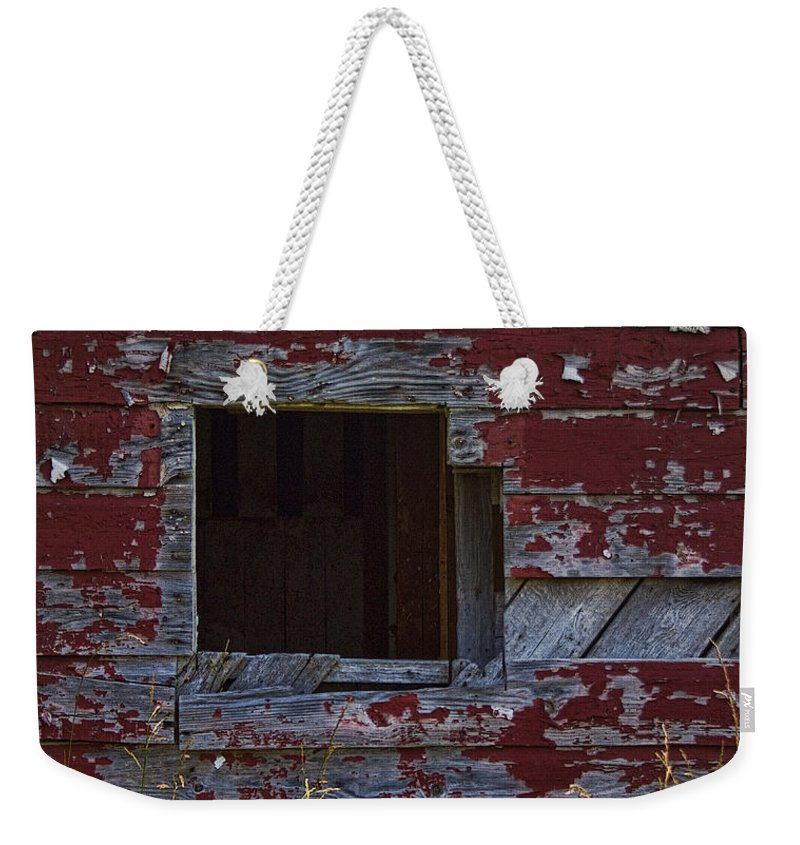 Red Weekender Tote Bag featuring the photograph Rustic Barn Red Peeling Paint by Kathy Clark