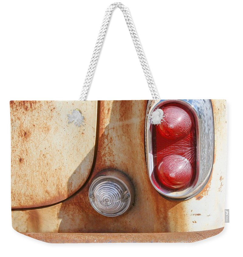 Automobile Weekender Tote Bag featuring the photograph Rusty Abandoned Old Car by Terry Fleckney