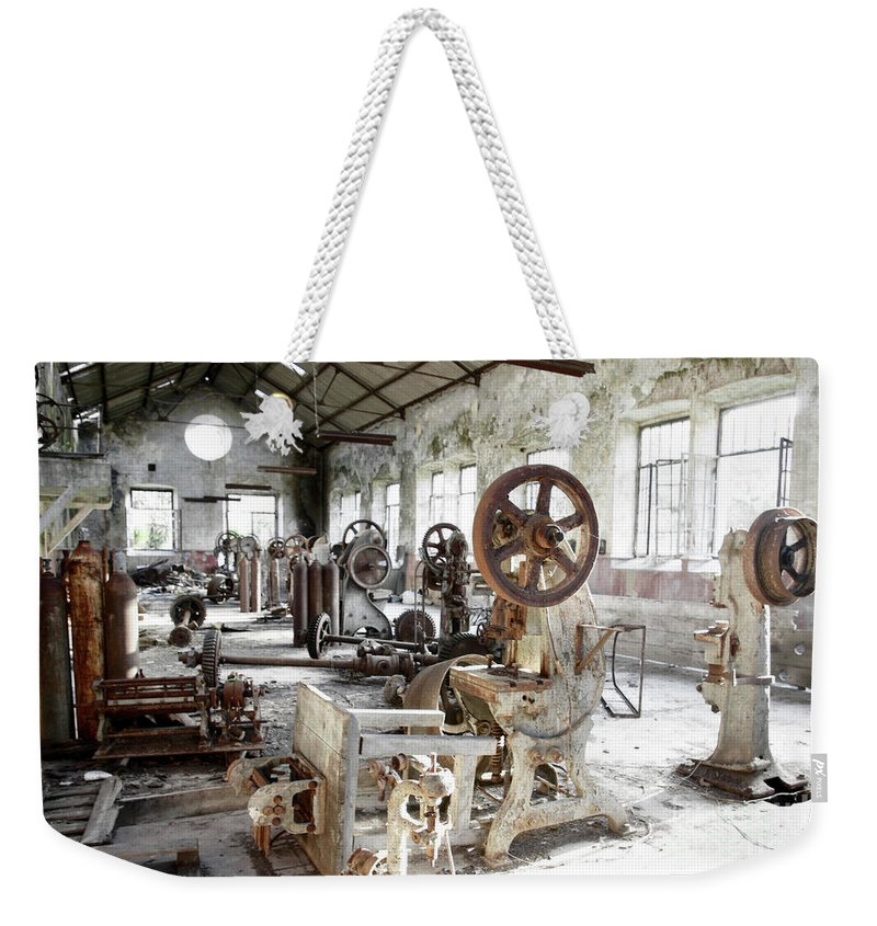 Abandoned Weekender Tote Bag featuring the photograph Rusty Machinery by Carlos Caetano