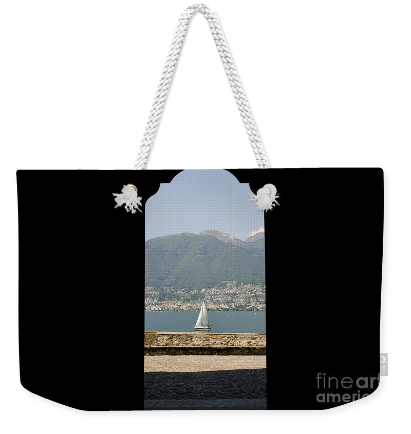 Sailing Boat Weekender Tote Bag featuring the photograph Sailing Boat Through An Open Door by Mats Silvan