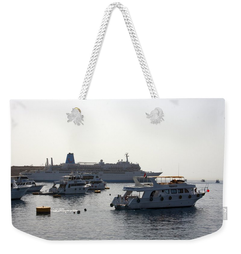 Boat Weekender Tote Bag featuring the photograph Sailing Boats And A Large Yacht In The Harbour At Sharm El Sheikh by Ashish Agarwal