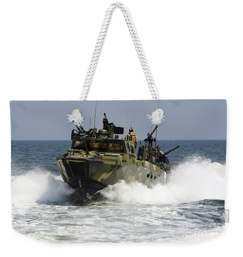 Riverine Command Boat Weekender Tote Bag featuring the photograph Sailors Navigate The Waters by Stocktrek Images