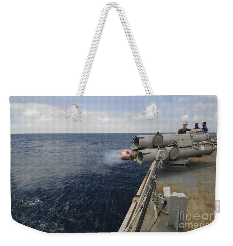Indian Ocean Weekender Tote Bag featuring the photograph Sailors Observe A Mk-46 Recoverable by Stocktrek Images